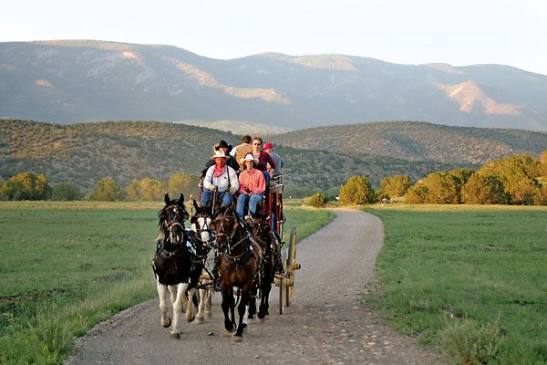 Traveling a New Mexico trail in the Rolls Royce of horse-drawn vehicles.