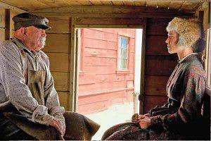 The Homesman-Mary-Bee-Cuddy-_Hilary-Swank_-Buster-Shaver-_Barry-Corbin