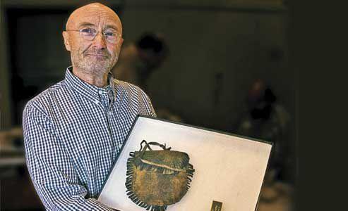 Rock-star-Phil-Collins-donating-Alamo-artifacts