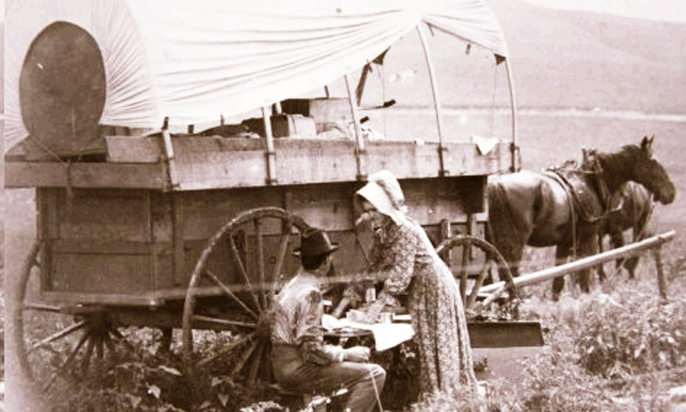 Pioneer Family Eating by the Wagon