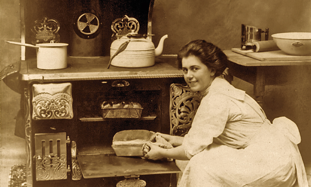 Woman Cooking in a 19th Century stove