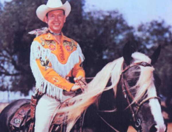 photograph of cowboy Rex Allen dressed in yellow on horse Koko