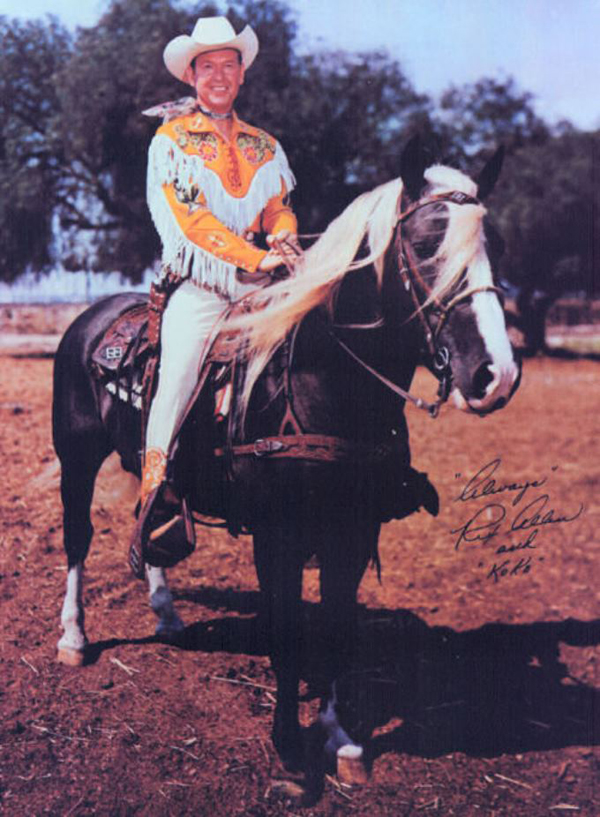 photograph of cowboy Rex Allen dressed in yellow on horse Koko