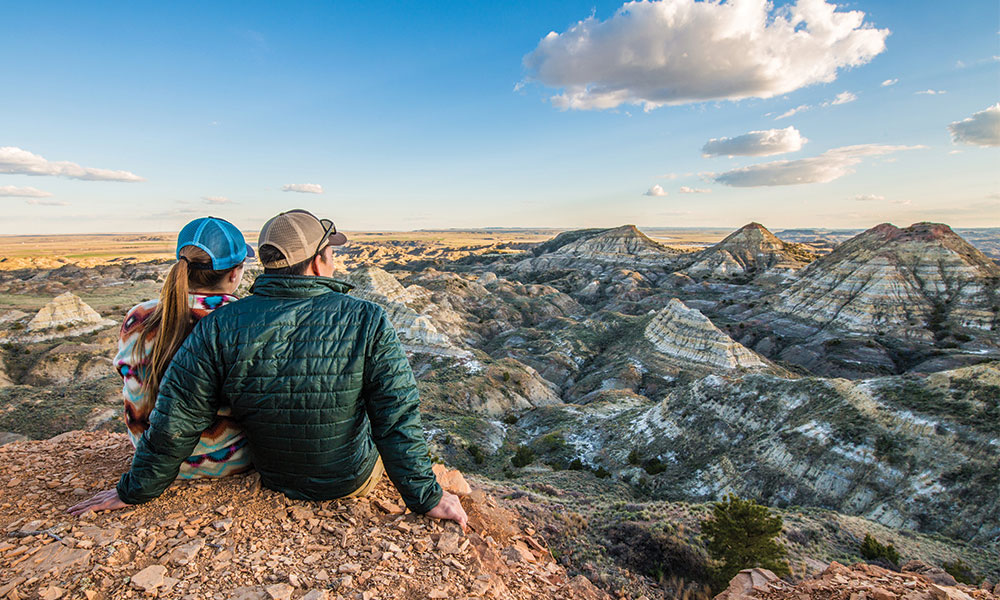 couple sitting mountain lookout Southeast Montana Travel
