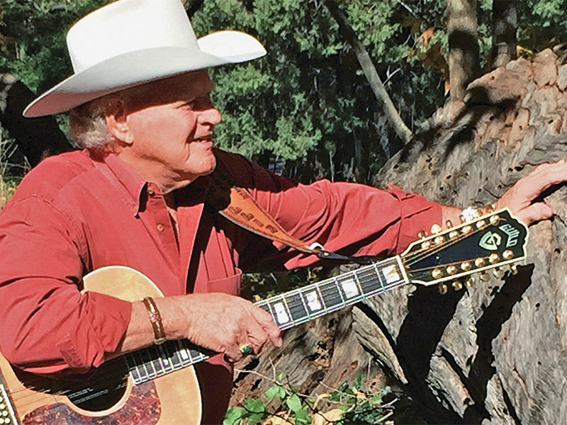 dolan ellis singer songwriter what history has taught me guitar hat cowboy true west magazine