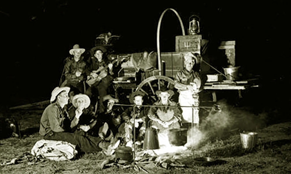 cowboys around a chuckwagon true west magazine