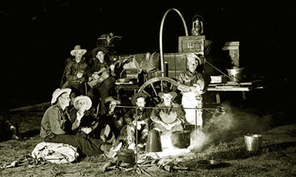 cowboys around a chuckwagon true west magazine