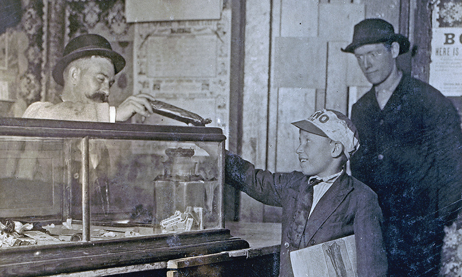 boy buying candy in an old west shop true west magazine