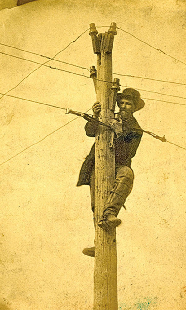 man with telegraph lines true west magazine