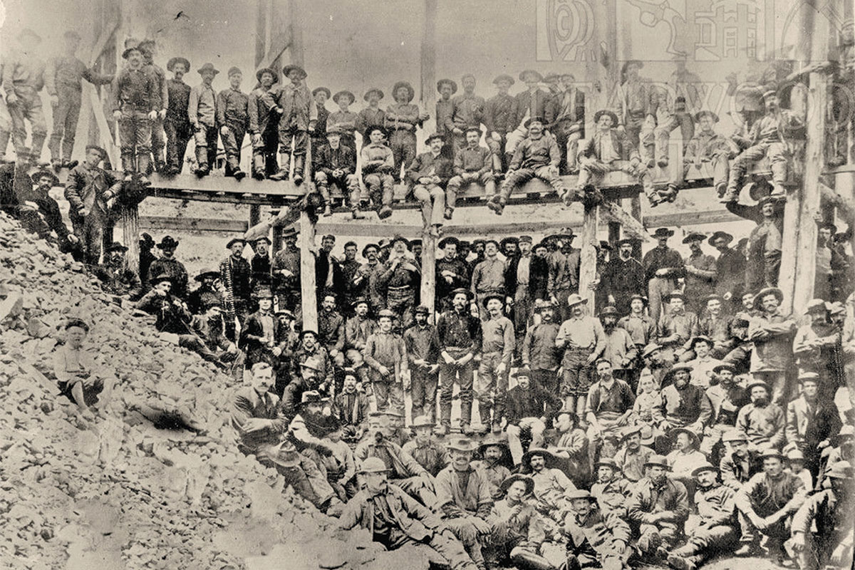 homestake mine and miners on bridge true west magazine
