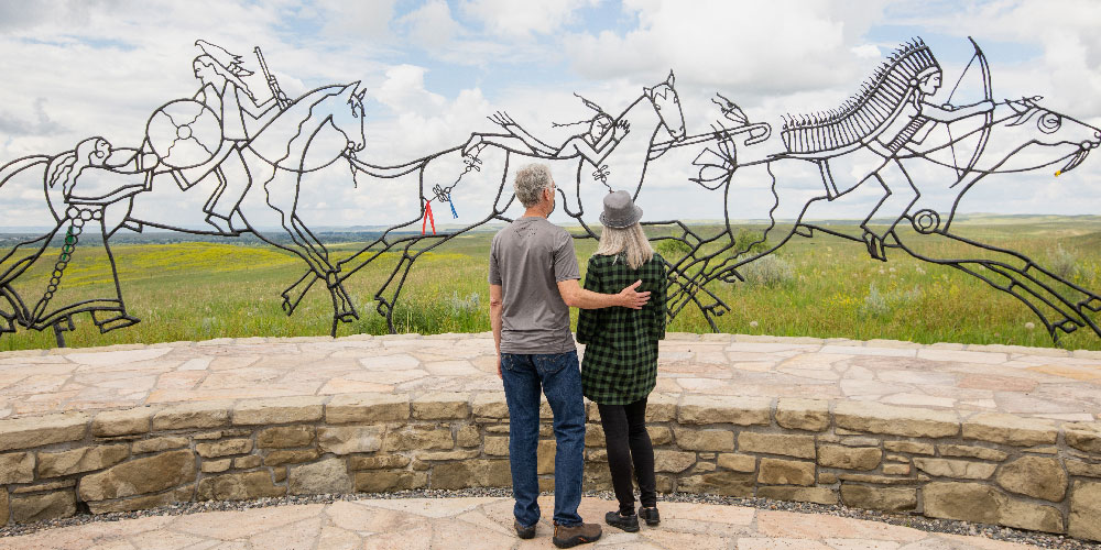 image of art in southeast montana with two people standing in front of it